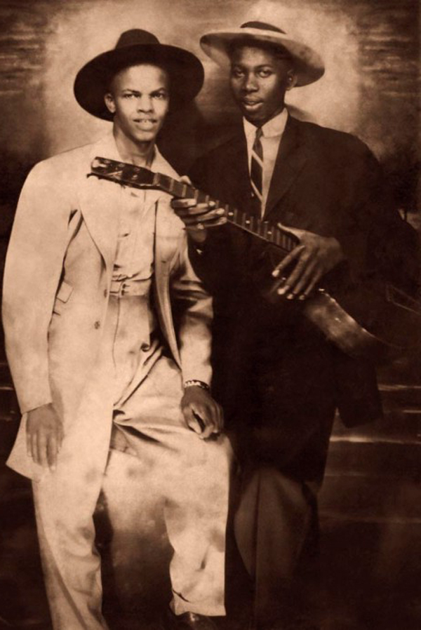 Legendary American Blues singer songwriter Robert Johnson (1911 - 1938), left, with fellow musician Johnny Shines (1915 - 1992), circa 1935. This image is one of only three known photographs of Johnson, has been extensively retouched. (Photo by Robert Johnson Estate/Hulton Archive/Getty Images)